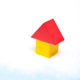 Stylized house standing in snow Royalty Free Stock Photo