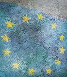 Image of flag of European Union against the old wall background. Stylized image of flag of European Union against the old wall background Stock Photos