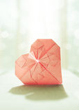 Stylized image of a paper origami heart with backlight  Royalty Free Stock Images