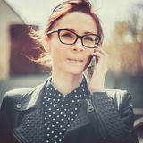 Stylized instagram colorized vintage fashion portrait of a young sexy woman wearing glasses with beauty bokeh and small depth of f Stock Photography