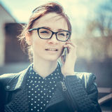 Stylized instagram colorized vintage fashion portrait of a young sexy woman wearing glasses with beauty bokeh and small depth of f Royalty Free Stock Photography