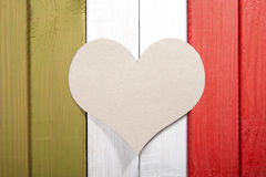 Stylized Italian flag with a cardboard heart in the middle. Royalty Free Stock Photography