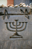 Stylized Jewish candlestick carved. Royalty Free Stock Images