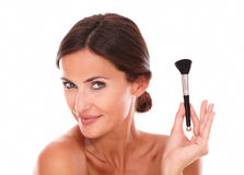 Stylized latin woman with make up brush Stock Photography