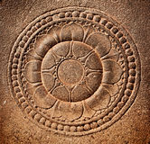 Stylized lotus carved on stone Stock Photo