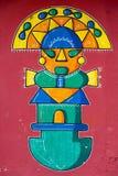 Stylized Maya graffiti on red wall in Banos, Ecuador Stock Photo