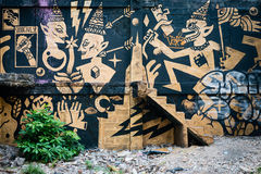 Stylized Mural by and Unknown Artist, Marred by Graffiti Stock Images