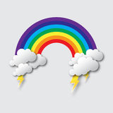 Stylized paper cutout clouds with lightning bolt and rainbow. Royalty Free Stock Photos