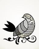 Bird on a limb. Stylized patterned bird on a limb Stock Images
