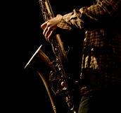 Stylized photo of the male saxophonis playing in sax Royalty Free Stock Images
