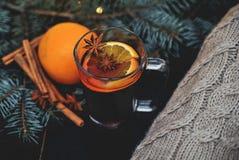 Stylized photo of mulled wine on a christmas background Royalty Free Stock Photo