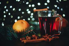 Stylized photo of mulled wine on a christmas background Stock Images