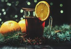 Stylized photo of mulled wine on a christmas background Stock Image