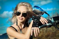 Stylized photo of woman and bike Stock Image