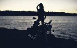 Stylized photo of woman and bike Royalty Free Stock Image
