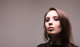 Stylized portrait of a brunette young adult woman Stock Image