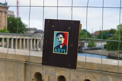 Stylized portrait of Edward Snowden on the fence. Royalty Free Stock Photos