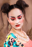 Stylized portrait of a Japanese geisha with bright make up Royalty Free Stock Photos