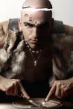 Stylized portrait of tribal man eating Stock Image
