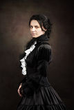 Stylized portrait of a victorian lady in black. Studio shot Royalty Free Stock Photo
