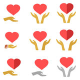 Stylized red heart on hands man and woman,  icons. Set on white background Royalty Free Stock Photo