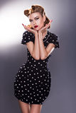 Stylized Retro Woman in Blue Polka Dot Dress - Vintage Style stock images