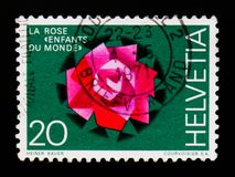 Stylized rose, Aid organisation Children of the World, circa 1971. MOSCOW, RUSSIA - SEPTEMBER 3, 2017: A stamp printed in Switzerland shows Stylized rose, Aid Stock Image
