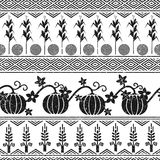 Stylized seamless background with wheat, corn, pumpkins, and native american indians symbols. Stylized seamless background. Tribal ornament Royalty Free Stock Photo
