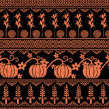 Stylized seamless background with wheat, corn, pumpkins, and native american indians symbols. Royalty Free Stock Photo