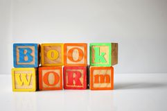 Stylized shot of & x22;Bookworm& x22; spelled out with ABC blocks. Back, to, school, alphabet, alphabetical, wooden, toy, student, children, kids, elementary royalty free stock photos