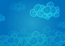 Stylized spiral clouds on the blue background Stock Photo