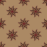 Stylized star anise seamless pattern. Brown background. Abstract texture. Stock Photos