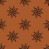 Stylized star anise seamless pattern. Brown elements on orange background. Stock Photo