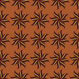 Stylized star anise seamless pattern. Brown elements on orange background. Royalty Free Stock Photo