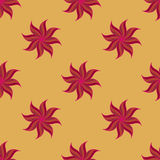 Stylized star anise seamless pattern. Red elements on yellow background. Stock Images