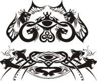 Stylized symmetriska karaktärsteckningar med drakar och katter Arkivbild