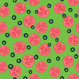 Stylized tomato and olive pattern. Stylized red tomato pattern with green background Royalty Free Stock Images