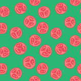 Stylized tomato pattern. Stylized red tomato pattern with green background Royalty Free Stock Photography