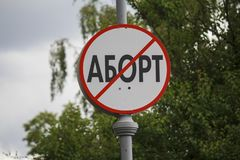 Stylized traffic sign with crossed out inscription `Abortion`. In Russian Stock Photo