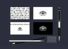 Stylized tree. The neutral black-and-white corporate identity with the stylized tree. Samples of business cards, a pen, a flash card, a pencil. Vector Stock Illustration