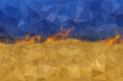 Stylized Ukrainian flag on fire. Polygonal background, stylized Ukrainian flag that separates the line of fire. The image symbolizes the war in Ukraine. Vector Stock Photo