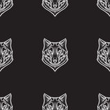 Stylized vector seamless background with wolves Royalty Free Stock Photos