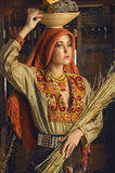 Stylized vintage portrait of young woman in ethno style Stock Photo