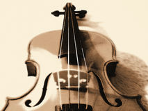 Stylized Violin in Sepia. Close up of sepia-toned violin / fiddle with watercolor effects Stock Image