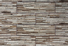 Stylized wall structure with brown and gray stones. Stock Photos