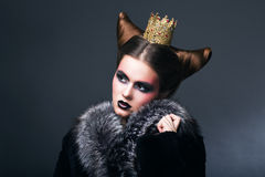 Stylized Woman in Fur Coat and Gold Grown. Nostalgia Royalty Free Stock Photo
