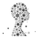 Stylized woman head, snowflakes. Winter season. Royalty Free Stock Photo