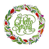 Stylized wreath with doodle flowers. Round floral frame for your text. Hello spring card template. Stock Images