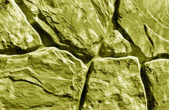 Stylized yellow stone wall texture. Abstract background and texture for design Stock Photo