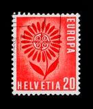 Stylizowany kwiat 22 liścia otacza CEPT odznakę, Europa C e P T 1964 - Kwiatu seria około 1964, Obraz Stock